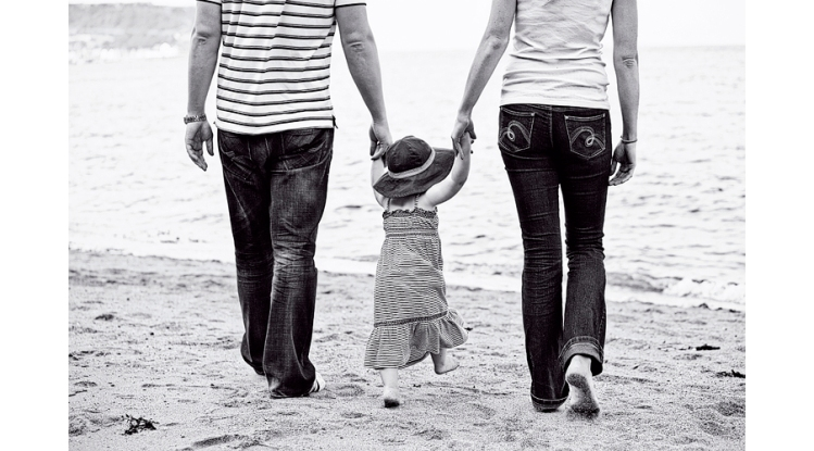 parents-child-holding-hands-beach-engagement-photography